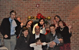 Who we are - the team being silly at Christmas.