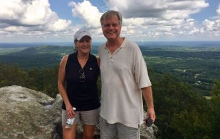John and Andrea on a mountain